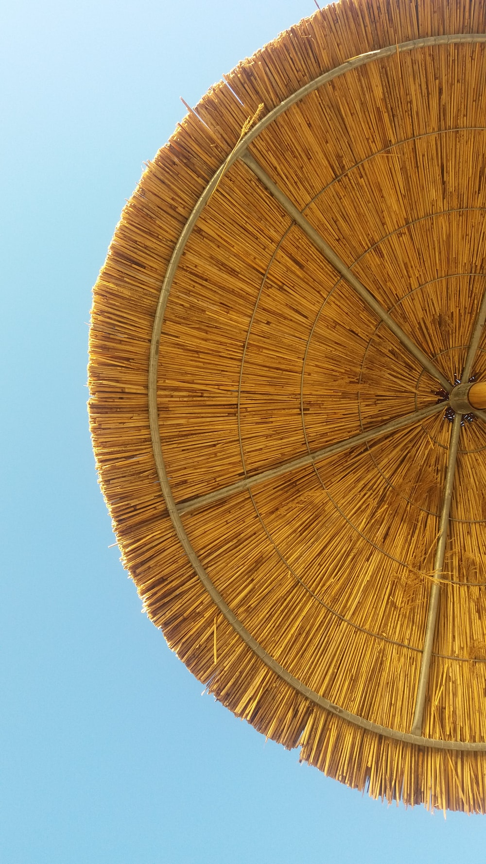 worm's-eye view photography of beige parasol
