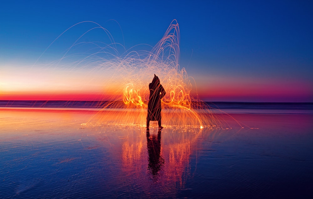 person with light effect surrounded with water