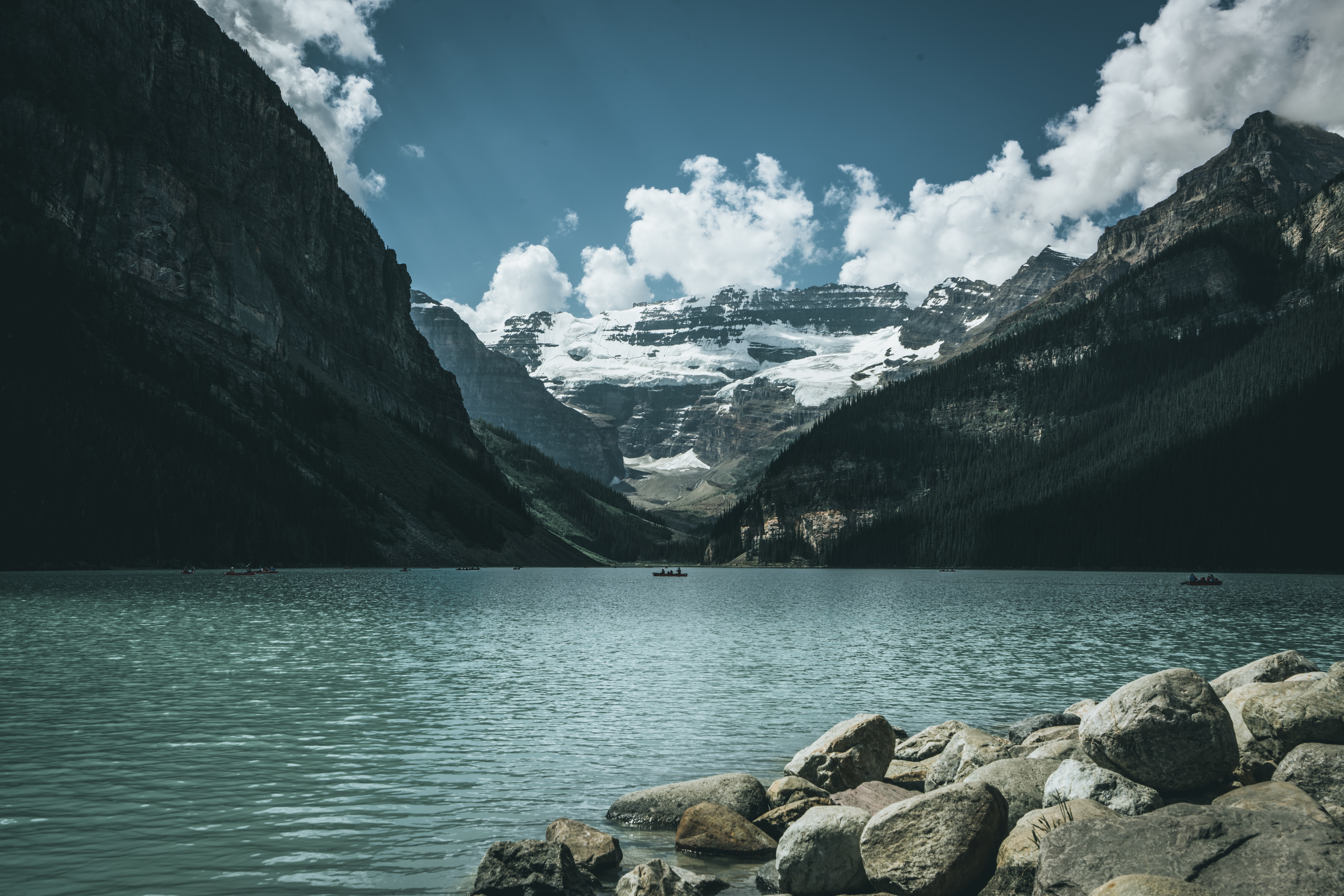 landscape photography of body of water between mountains