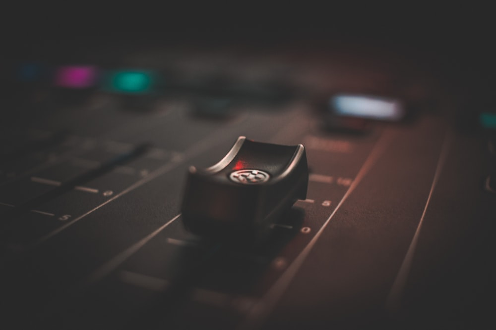 selective focus photography of mixing console
