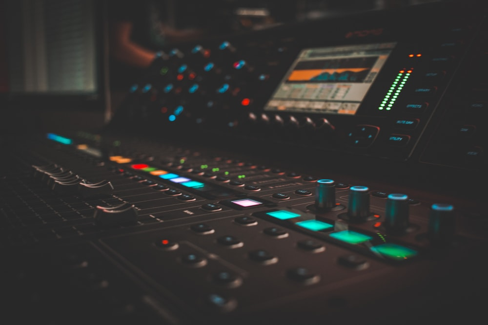 close-up photography of turned on audio mixer