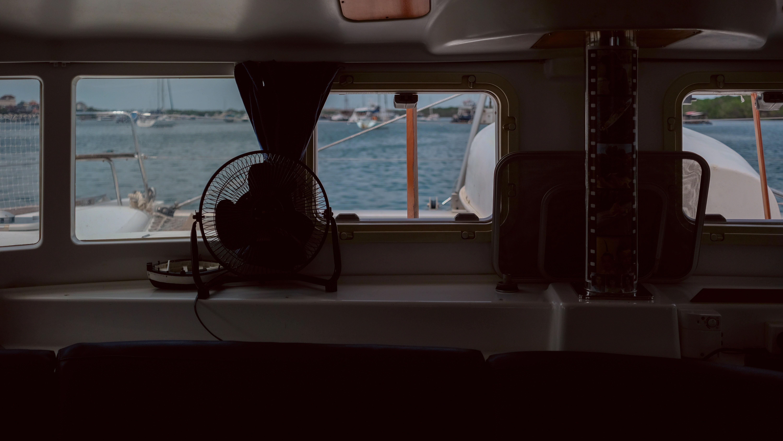 low-light photo of fan on table inside boat