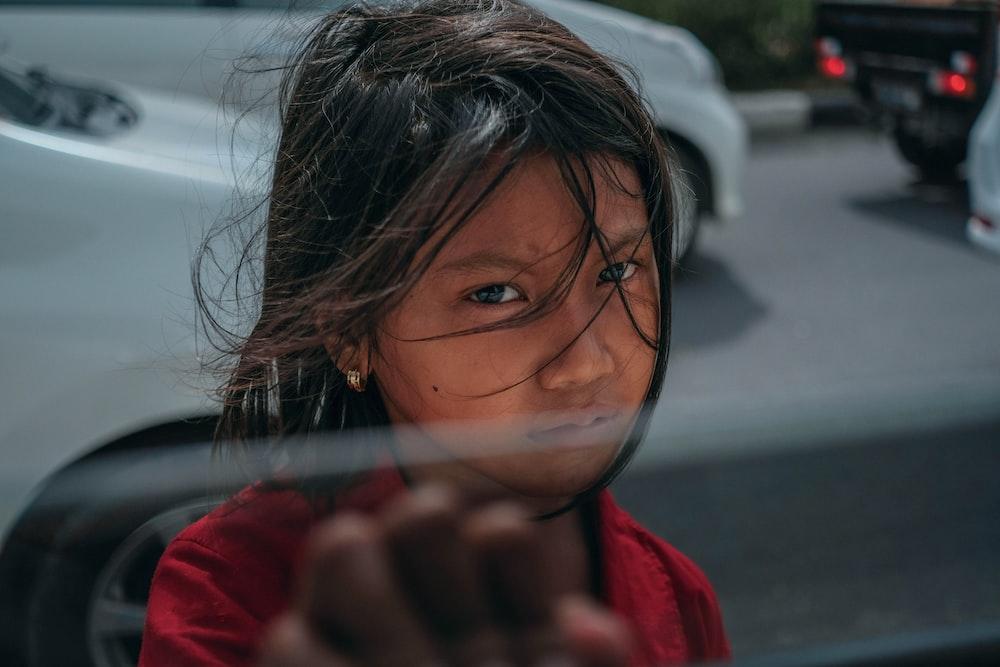 girl standing near vehicle