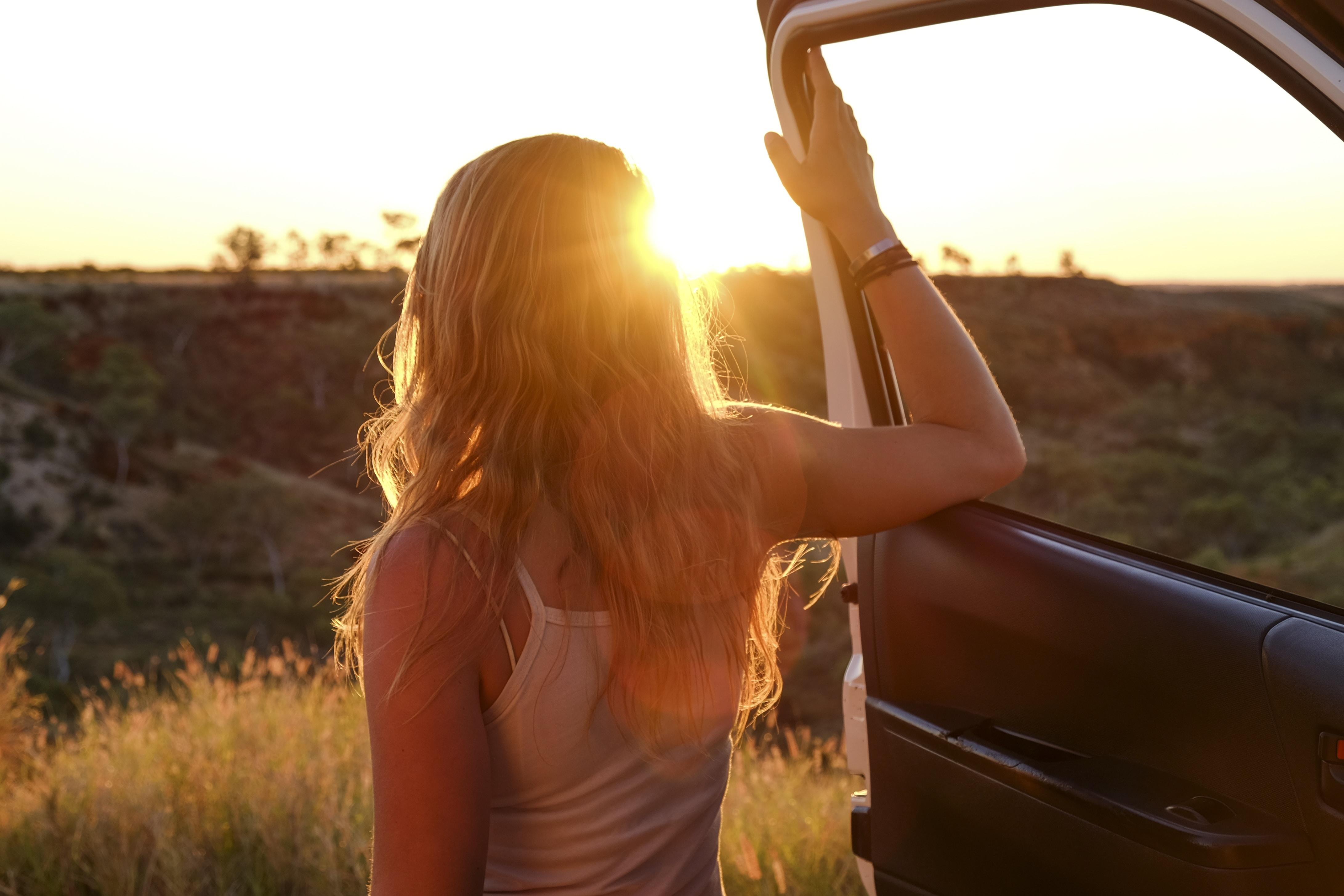 woman holding vehicle door