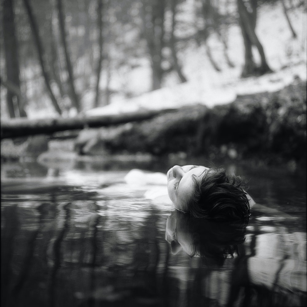 woman floating of body of water