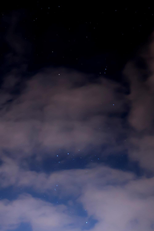 clouds under starry night