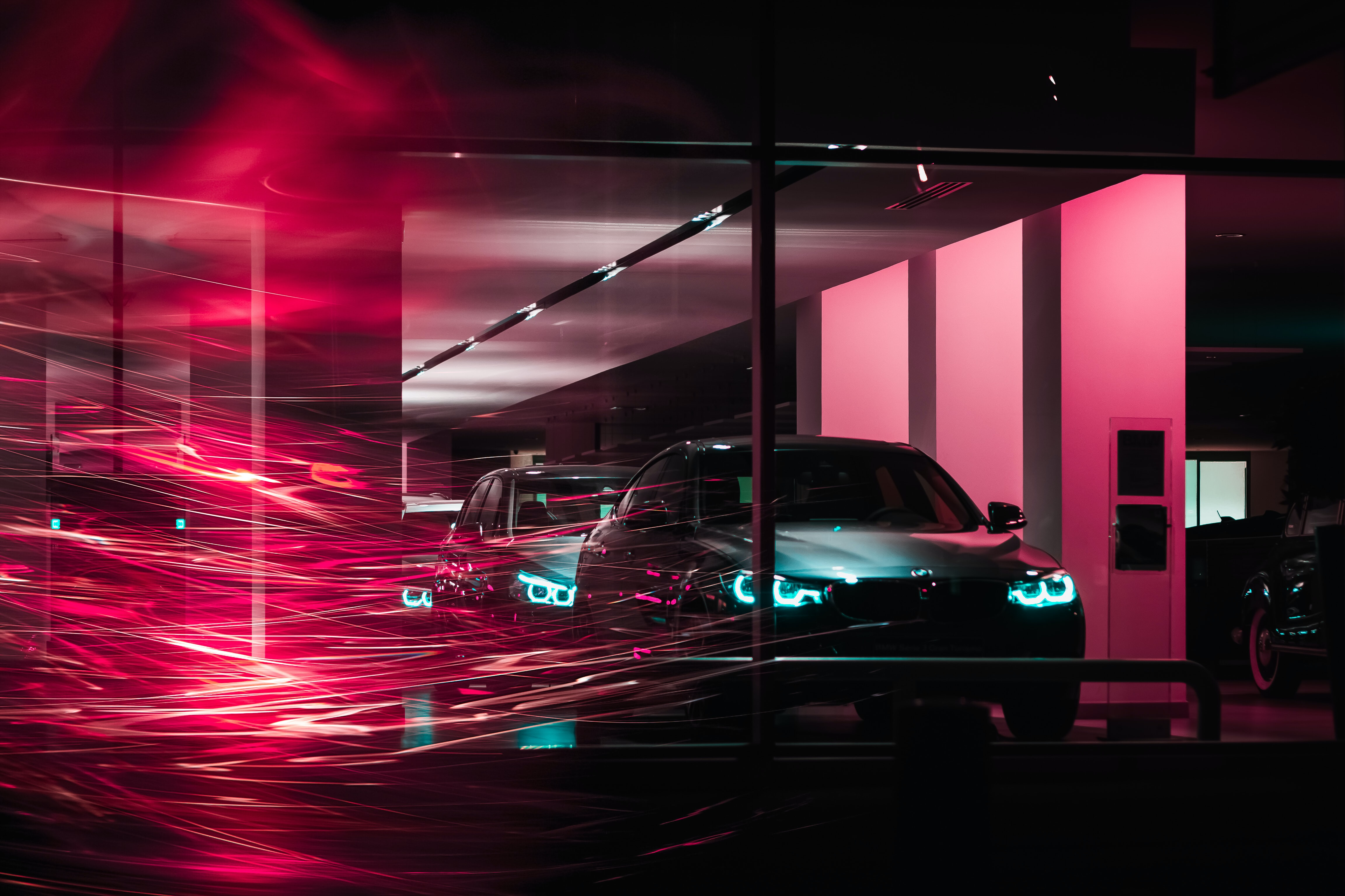 photography of two cars inside building