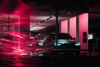 photography of two cars inside building bmw teams background