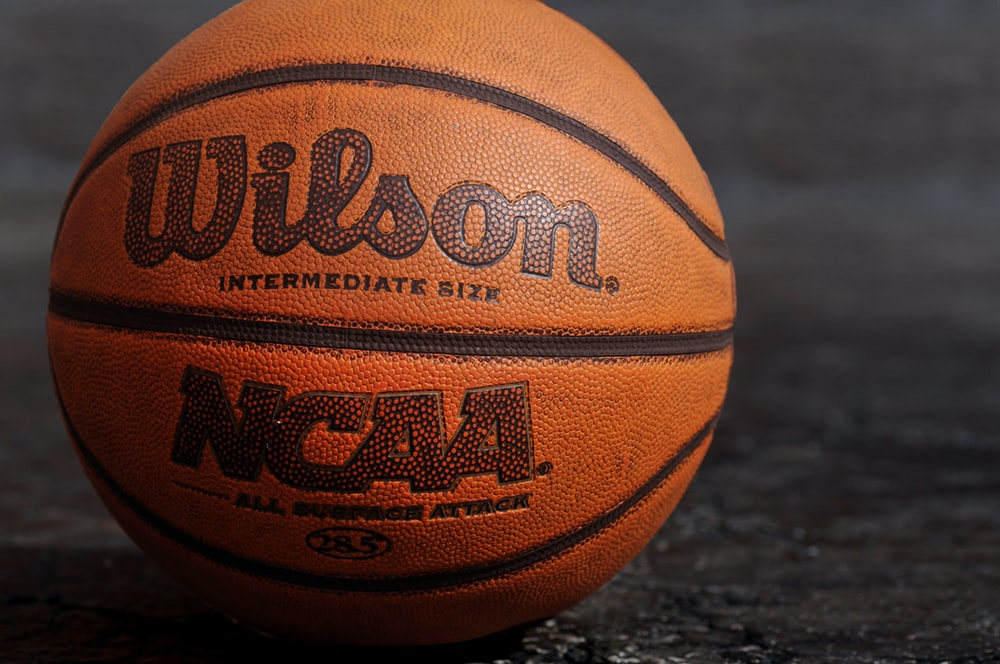 Wilson NCAA basketball on black board