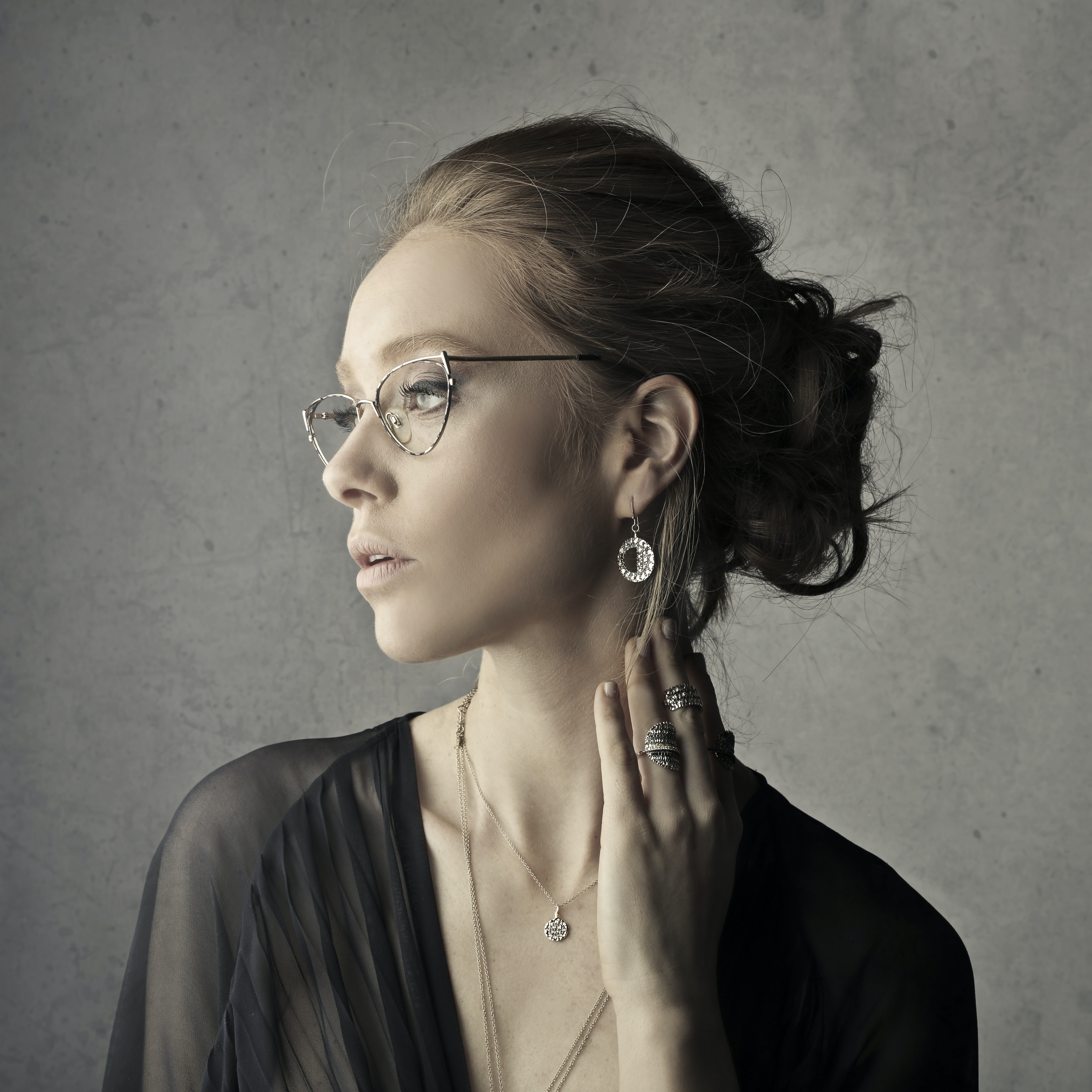 woman holding her neck while facing left