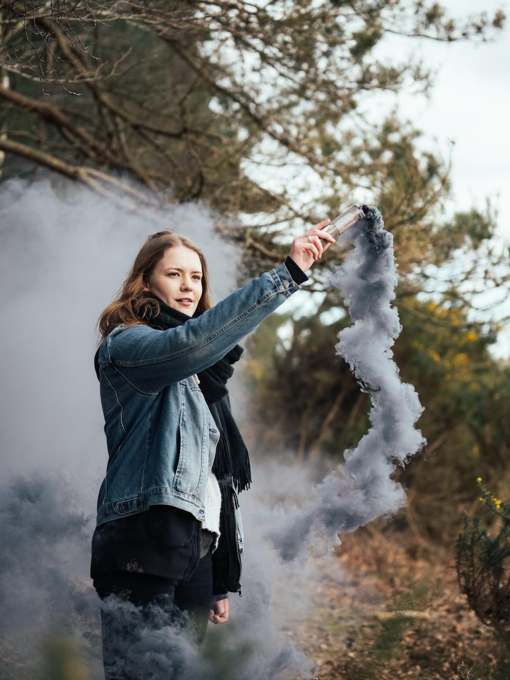 woman holding smoking device