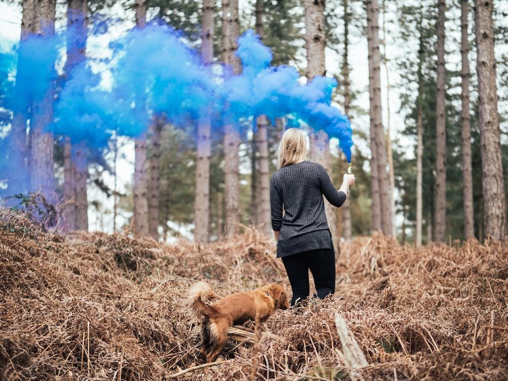 person holding blue smoke