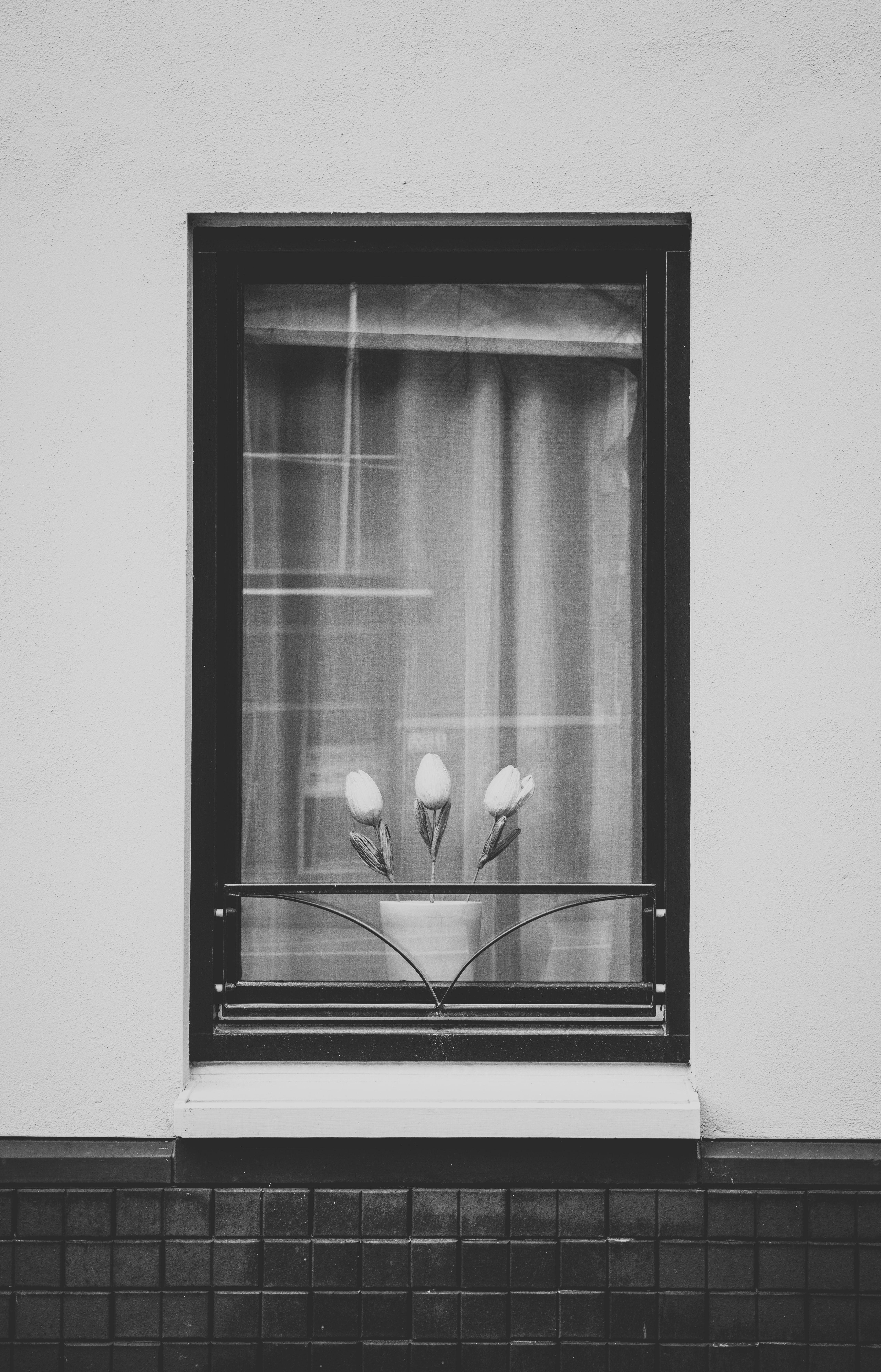 grayscale photography of black window frame