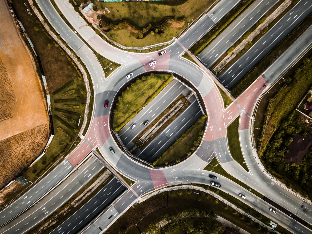 aerial photography of vehicles running on vehicle intersection route at daytime