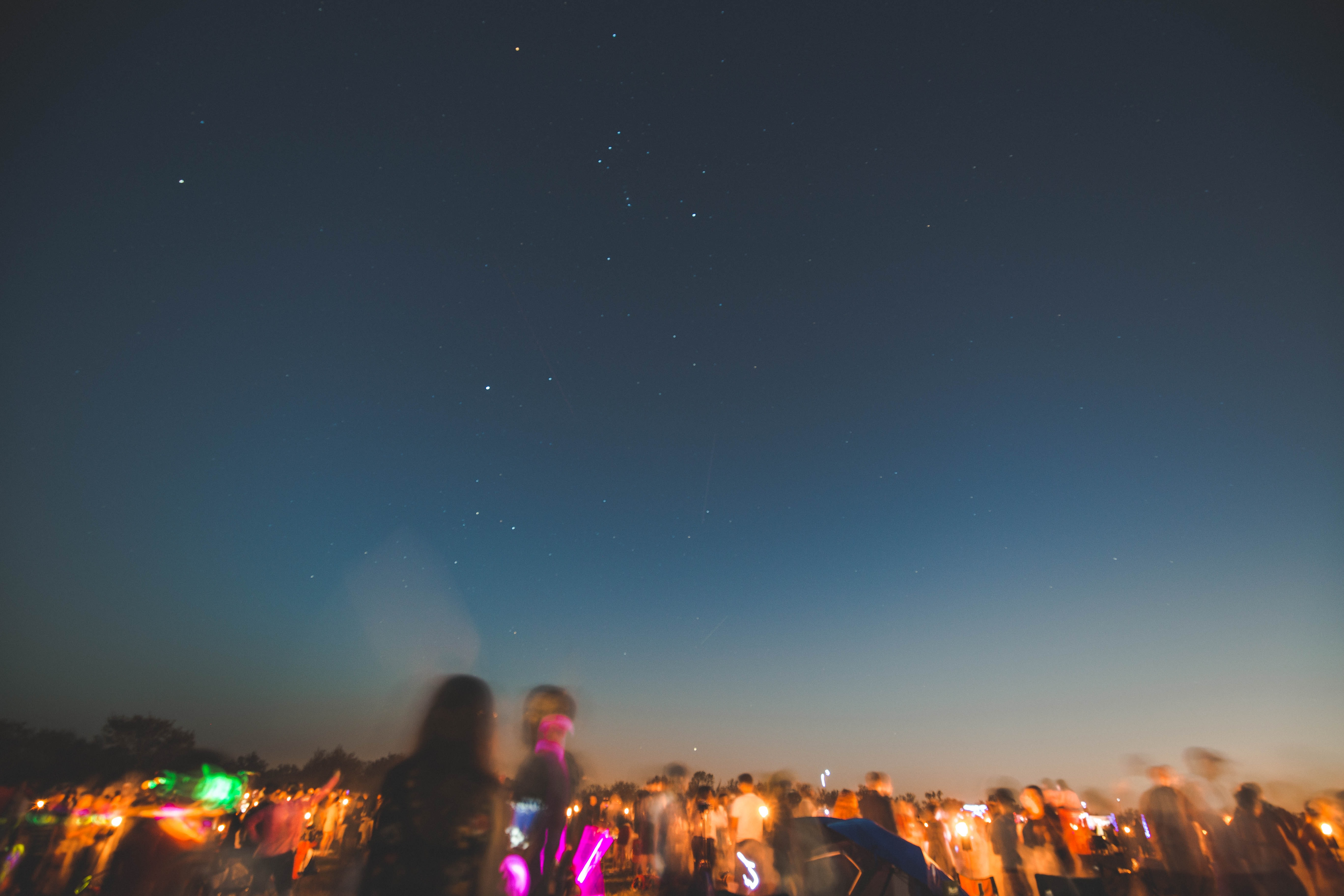 people standing on land at night time