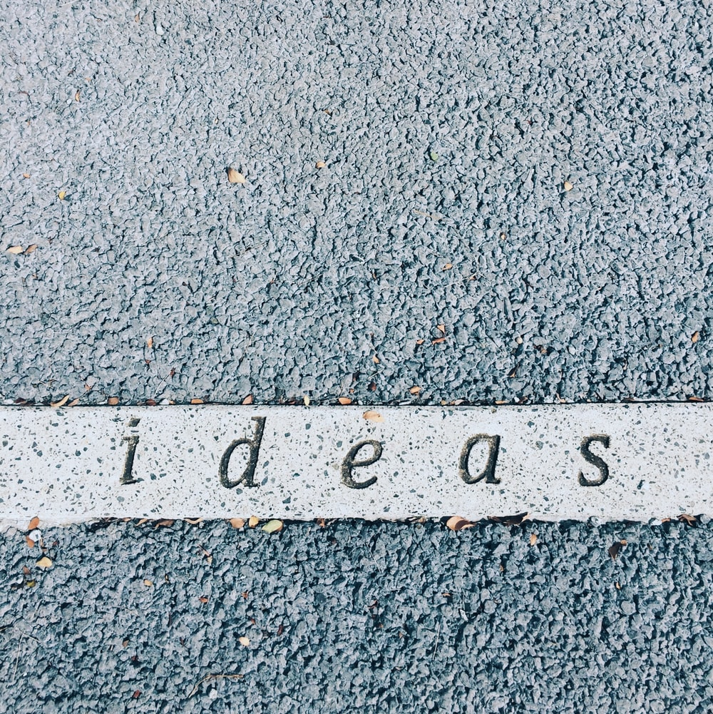 ideas carved on concrete surface