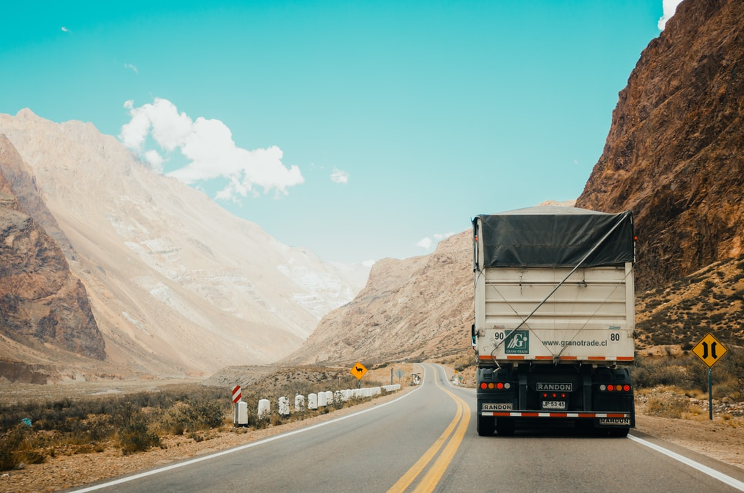 truck in between the mountains