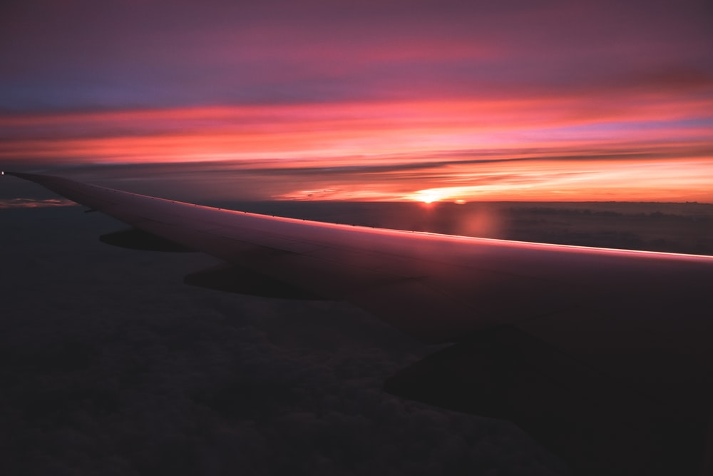 view of orange sunset from airplane