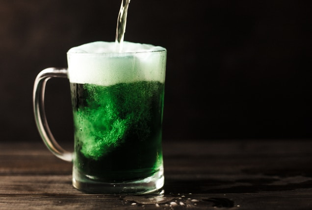 clear glass mug filled with green liquid