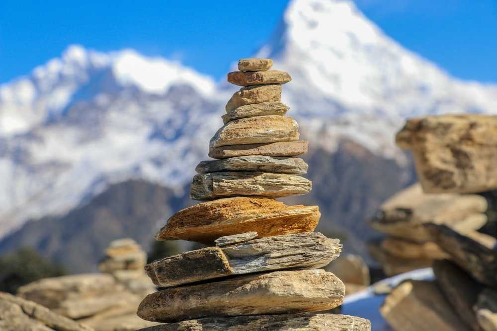 selective focus photo of stone stacking
