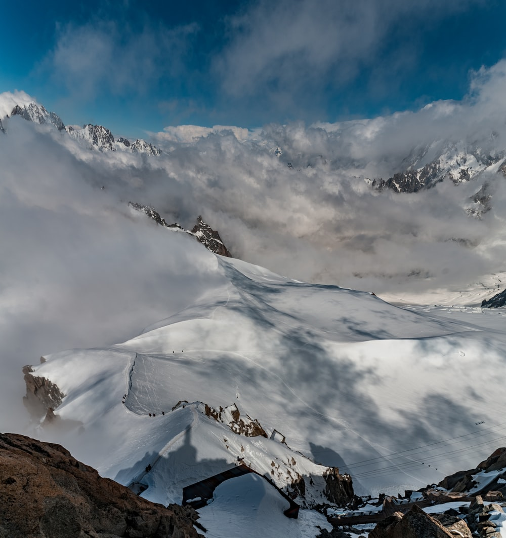 bird's eye photography of mountain surrounding snow
