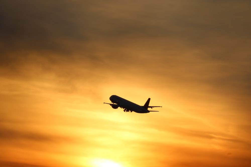 silhouette of flying airplane