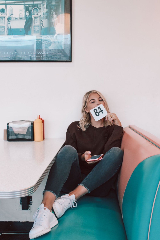 woman sitting on sofa near white table