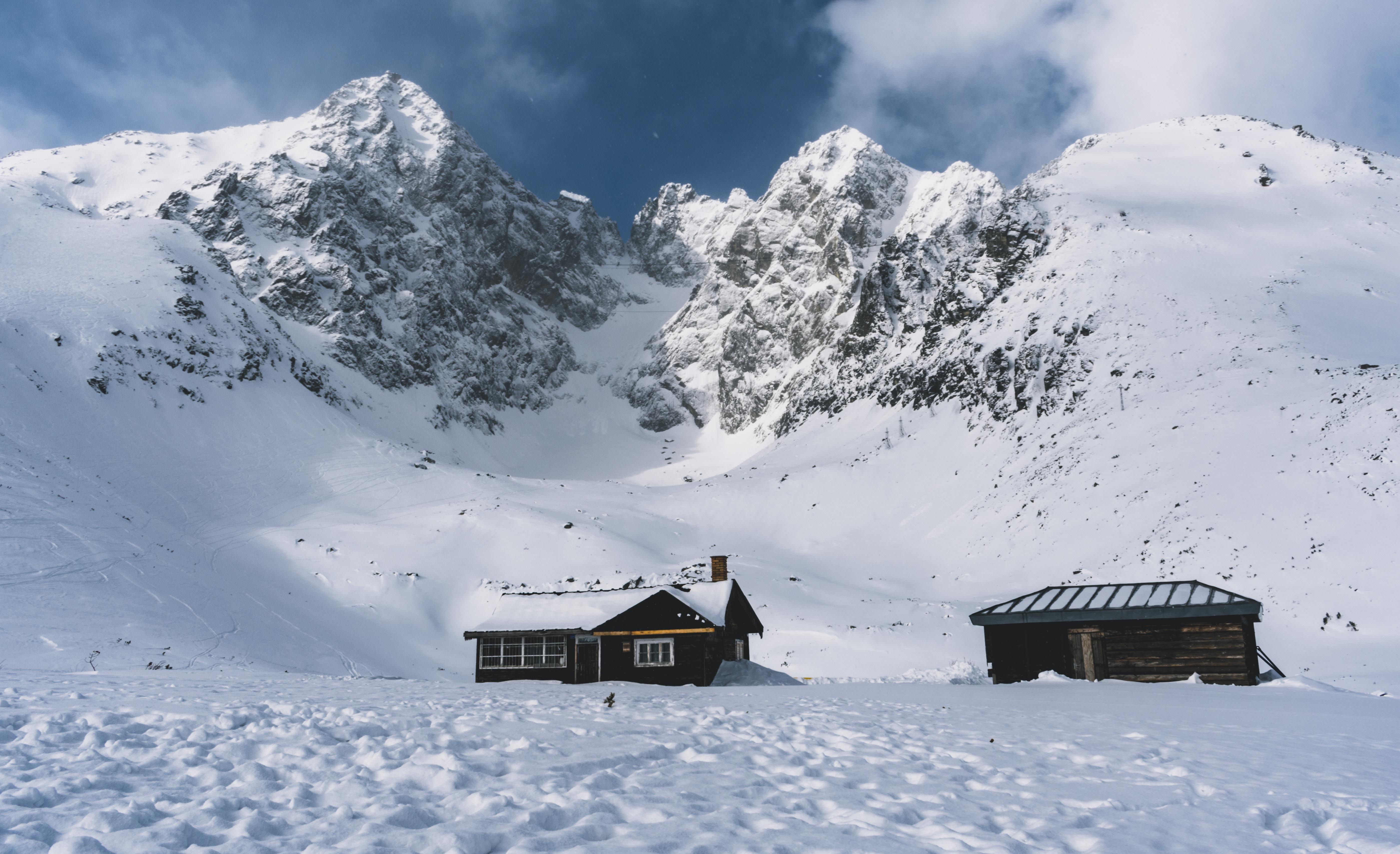 photo of house near snowy mountain