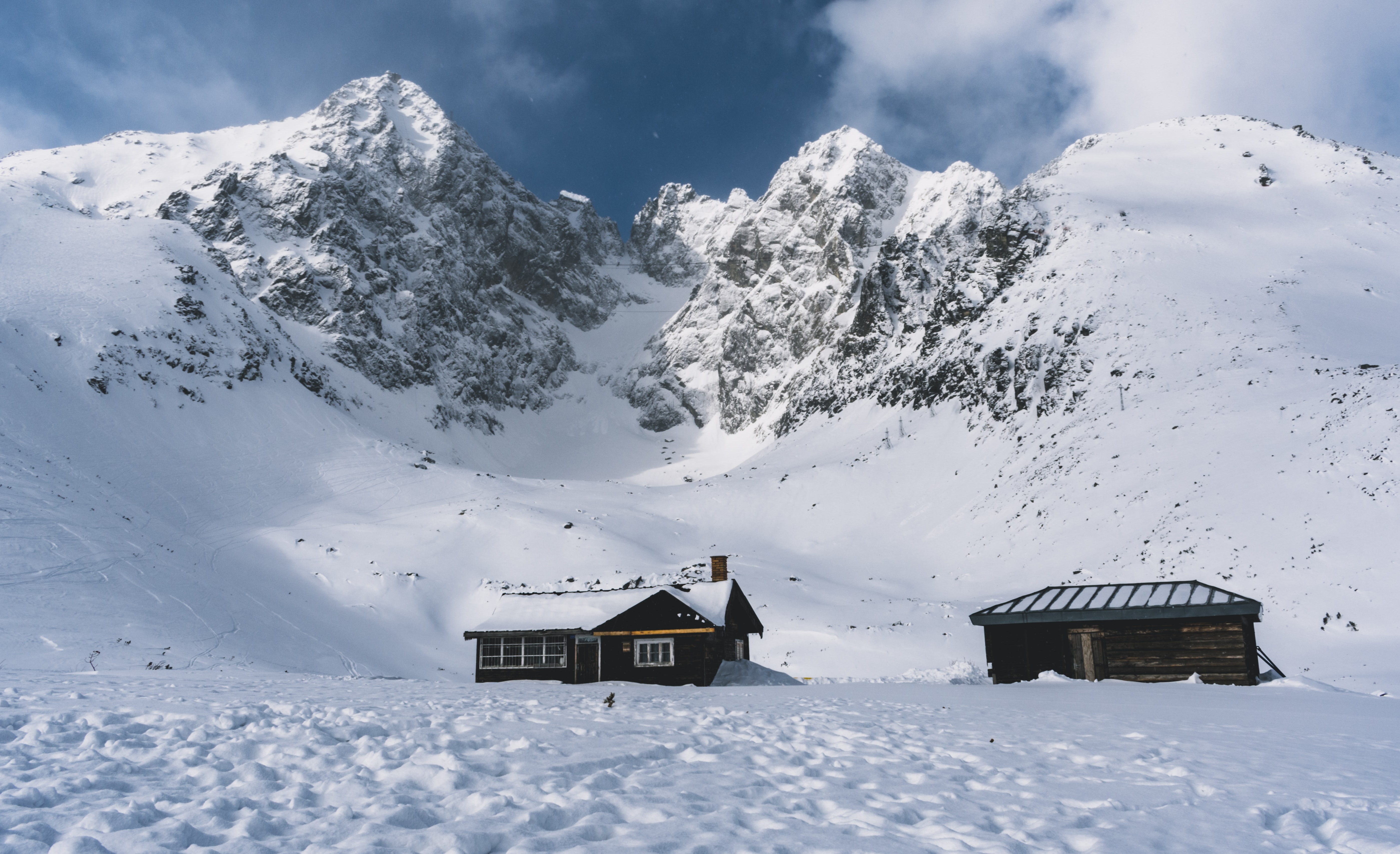 photo of house near snowy mountain