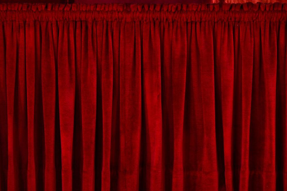 closeup photo of red rod pocket curtain