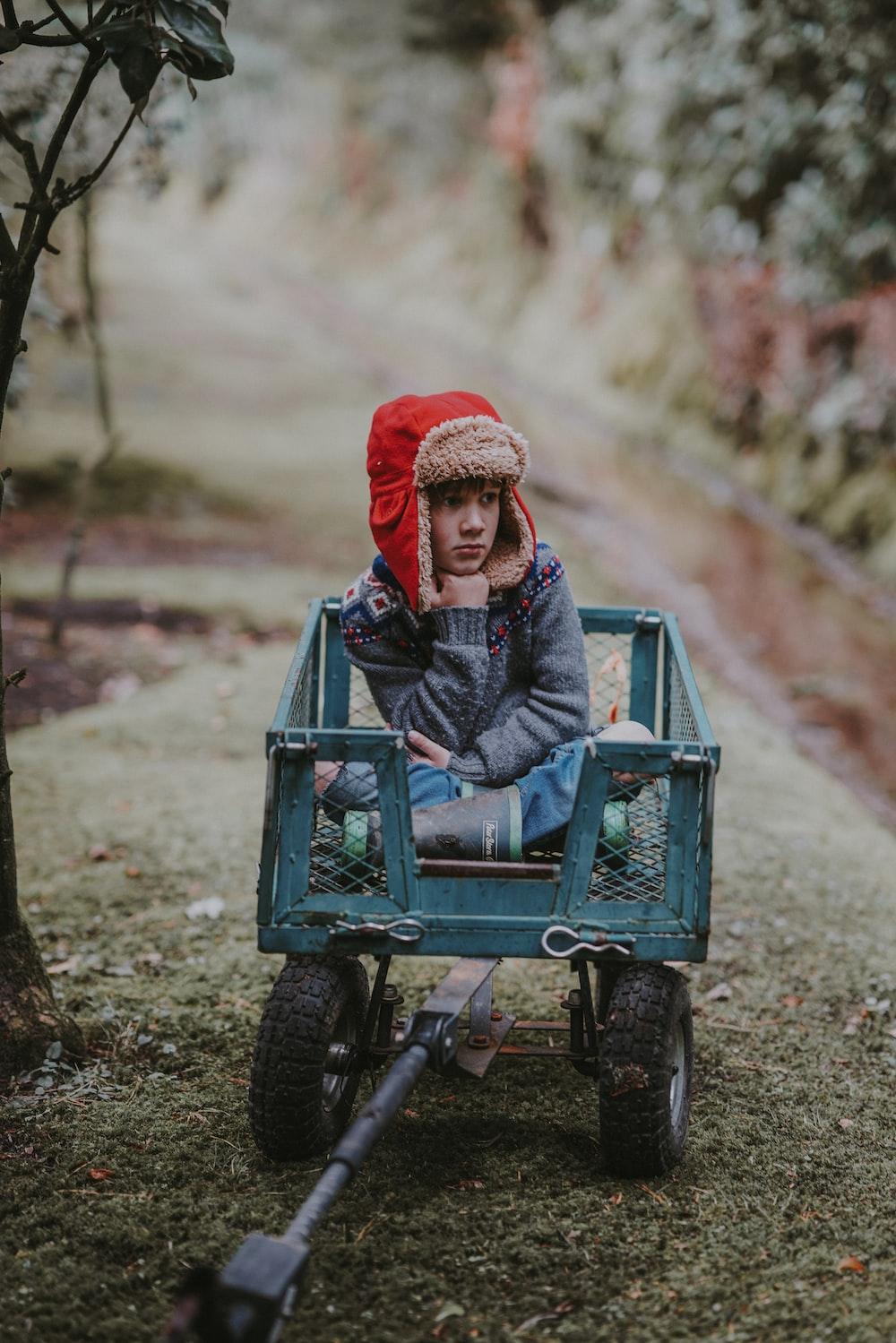girl riding on utility trailer