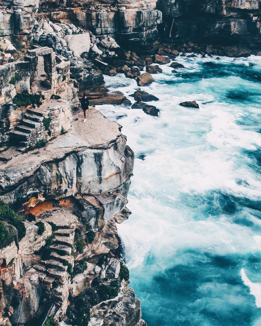 person near cliff