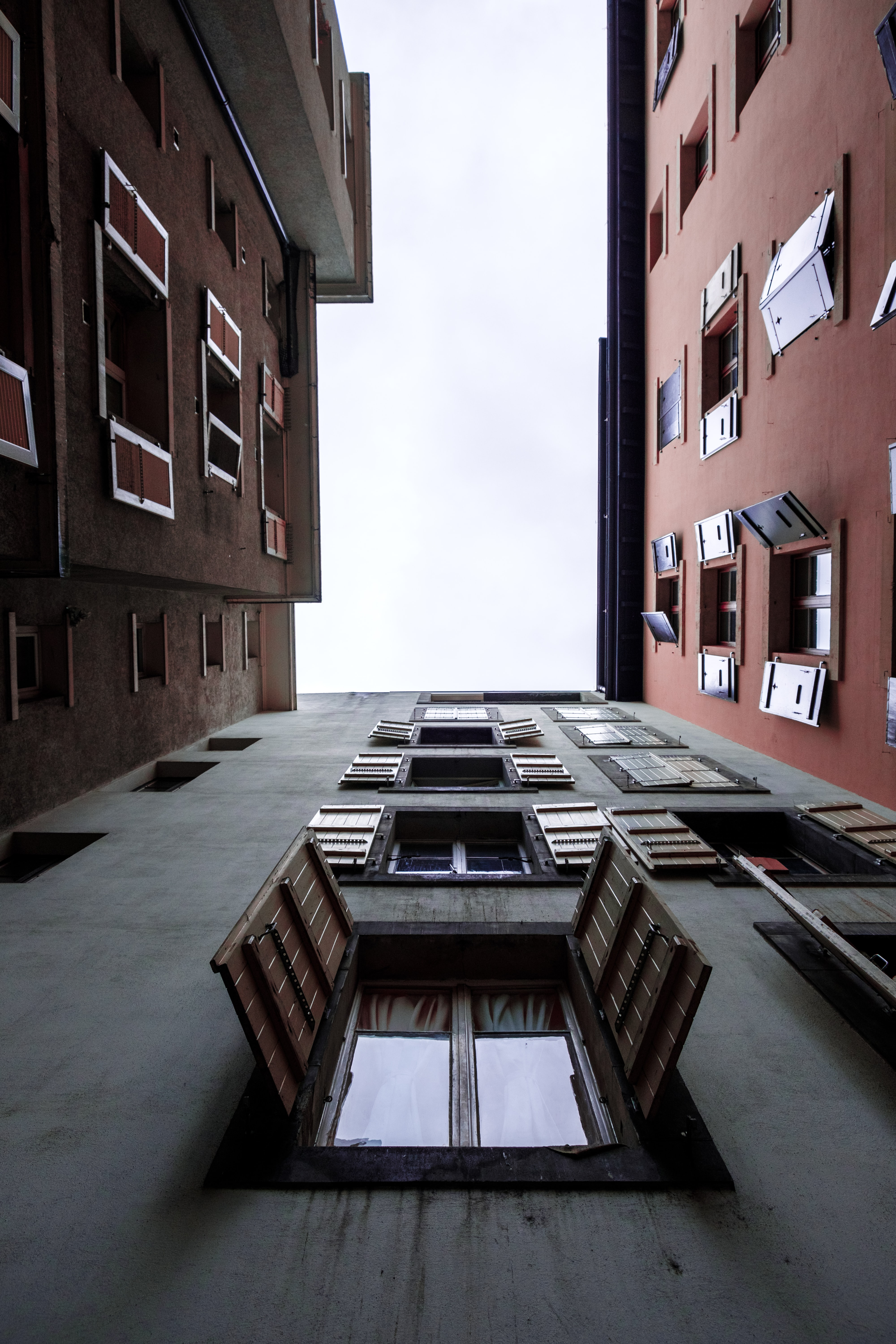 low angle photography of building with open windows at daytime