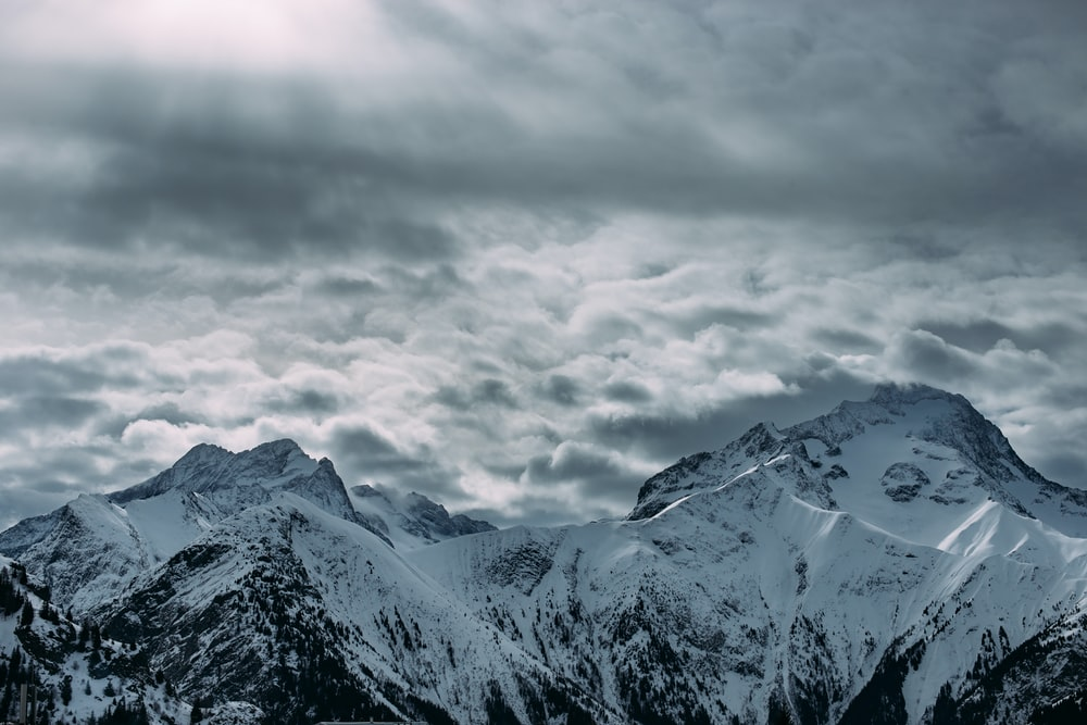 photo of snow coated mountain