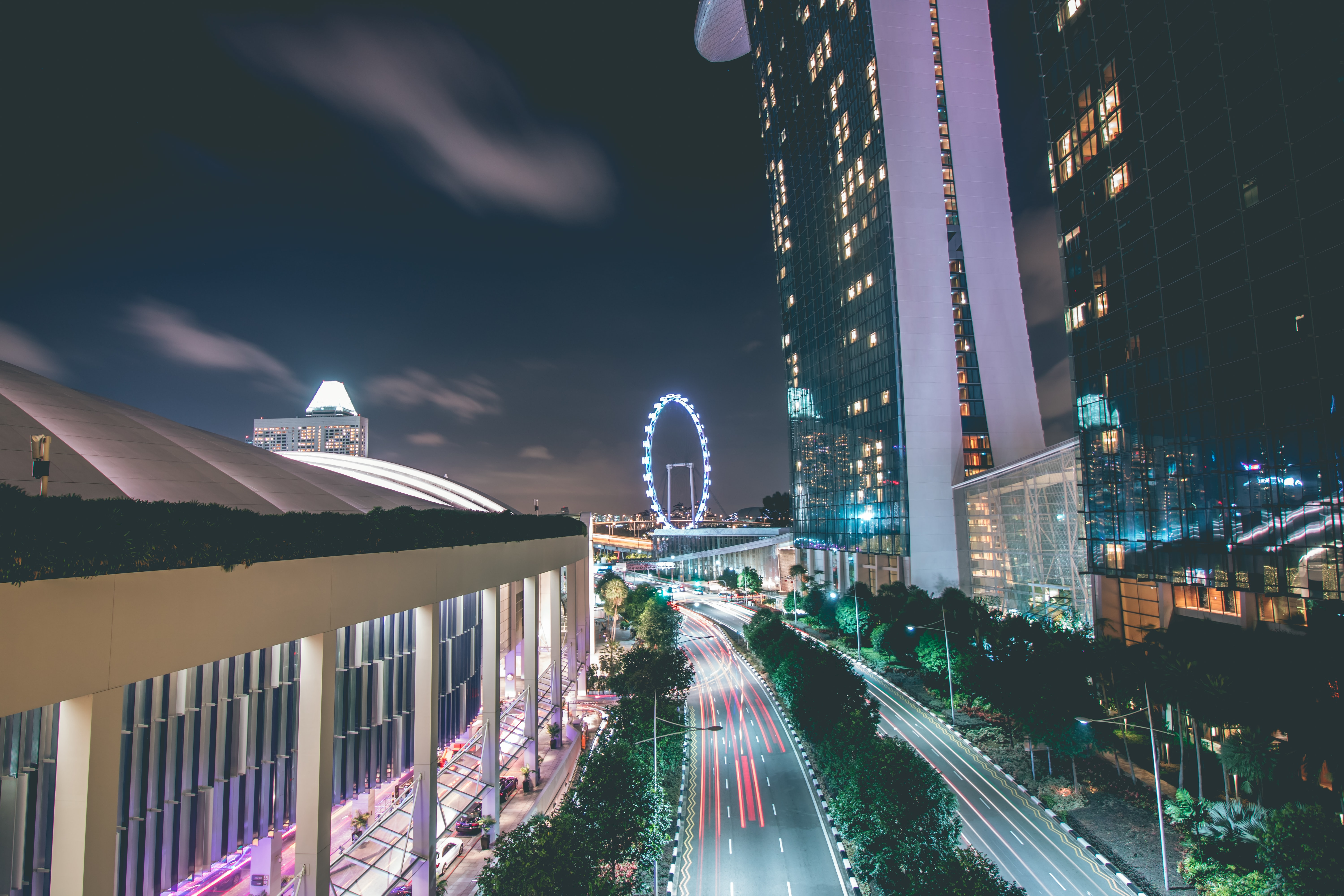 time lapse photography of Marina Bay Sands beside road