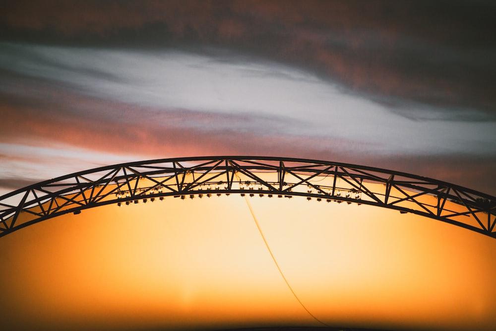 arch black truss during golden hour