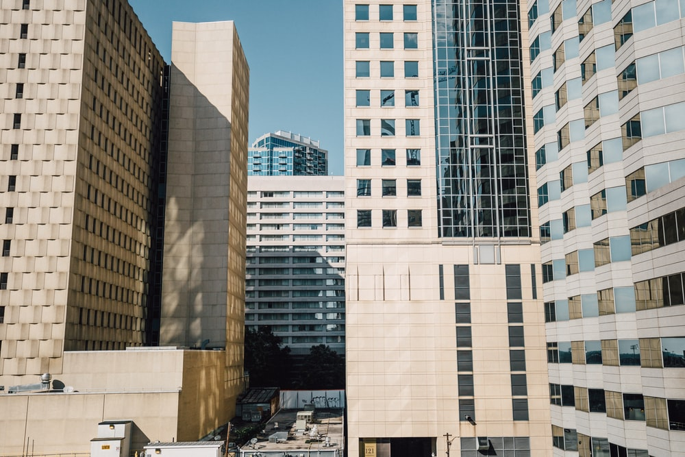 photo of white buildings during daytime
