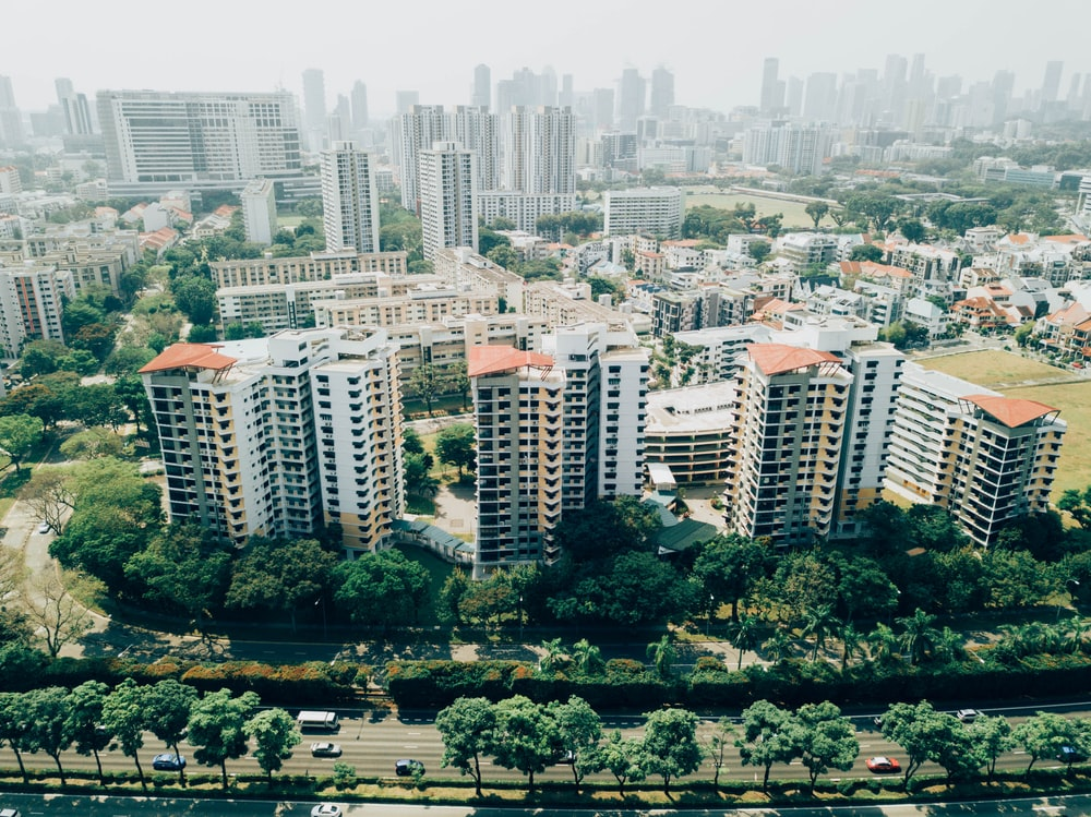 white and orange concrete buildings aerial photography