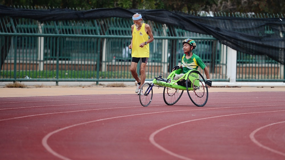 man using green wheelchair for walking