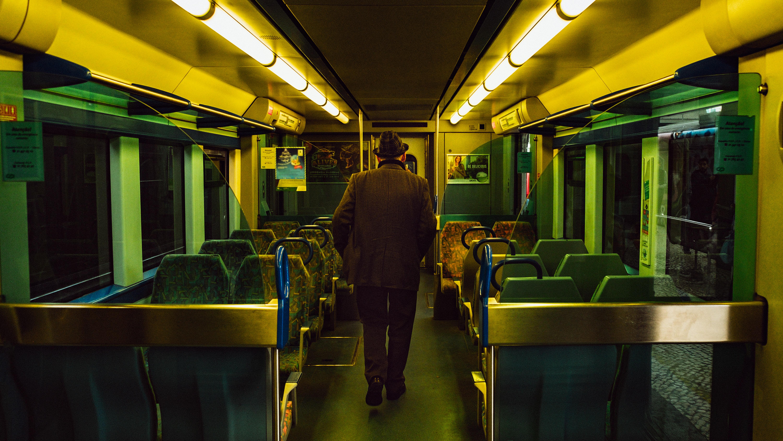 man walking inside train