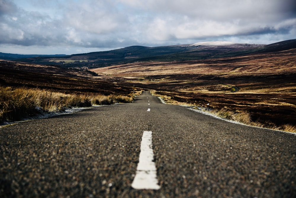 road between grass field