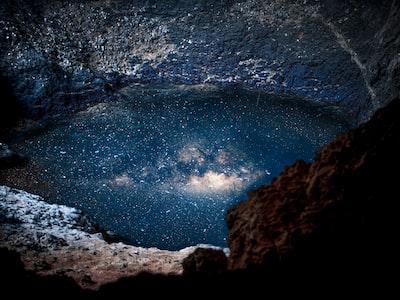 body of water reflecting night sky