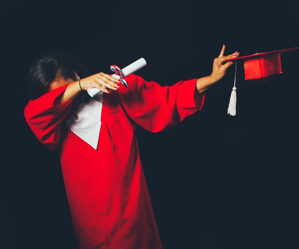 person wearing red graduation dress, Tacoma dispensary, using marijuana in college