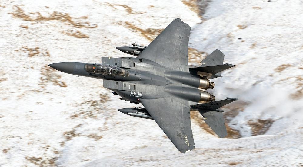 flying black f14 tomcat in sky