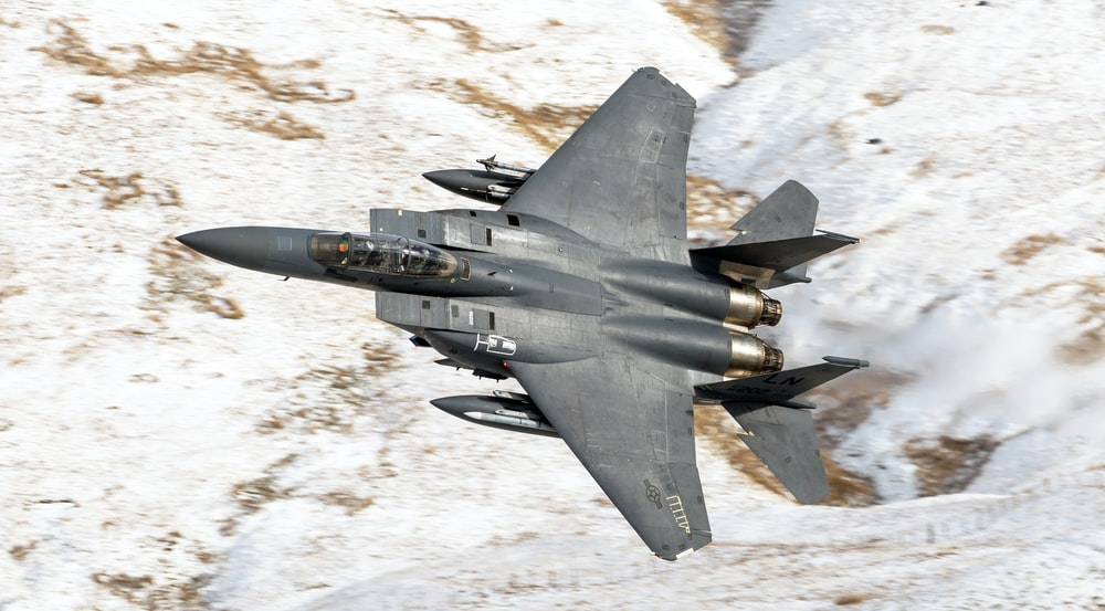 flying black f14 tomcat in sky