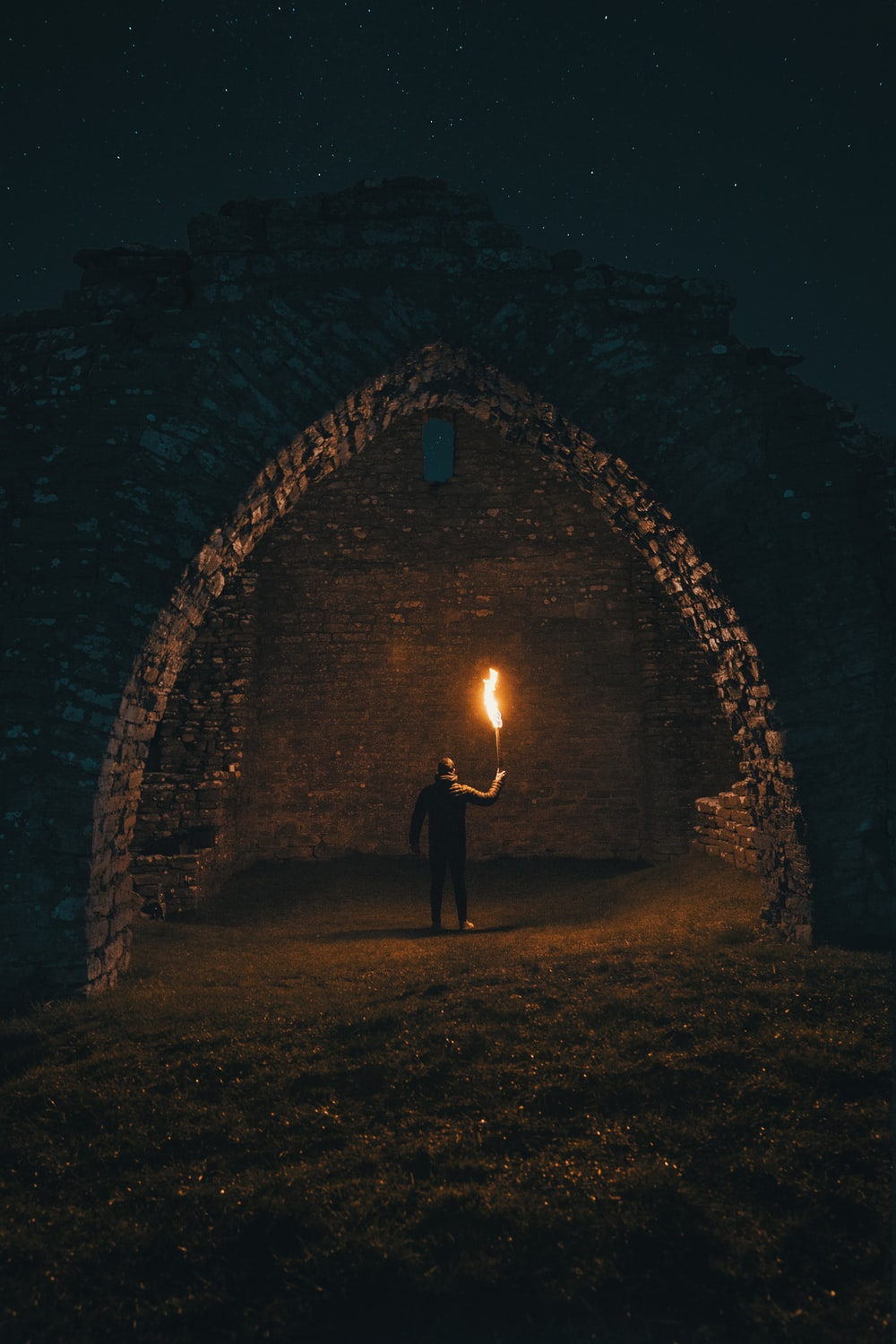 person holding torch in building interior