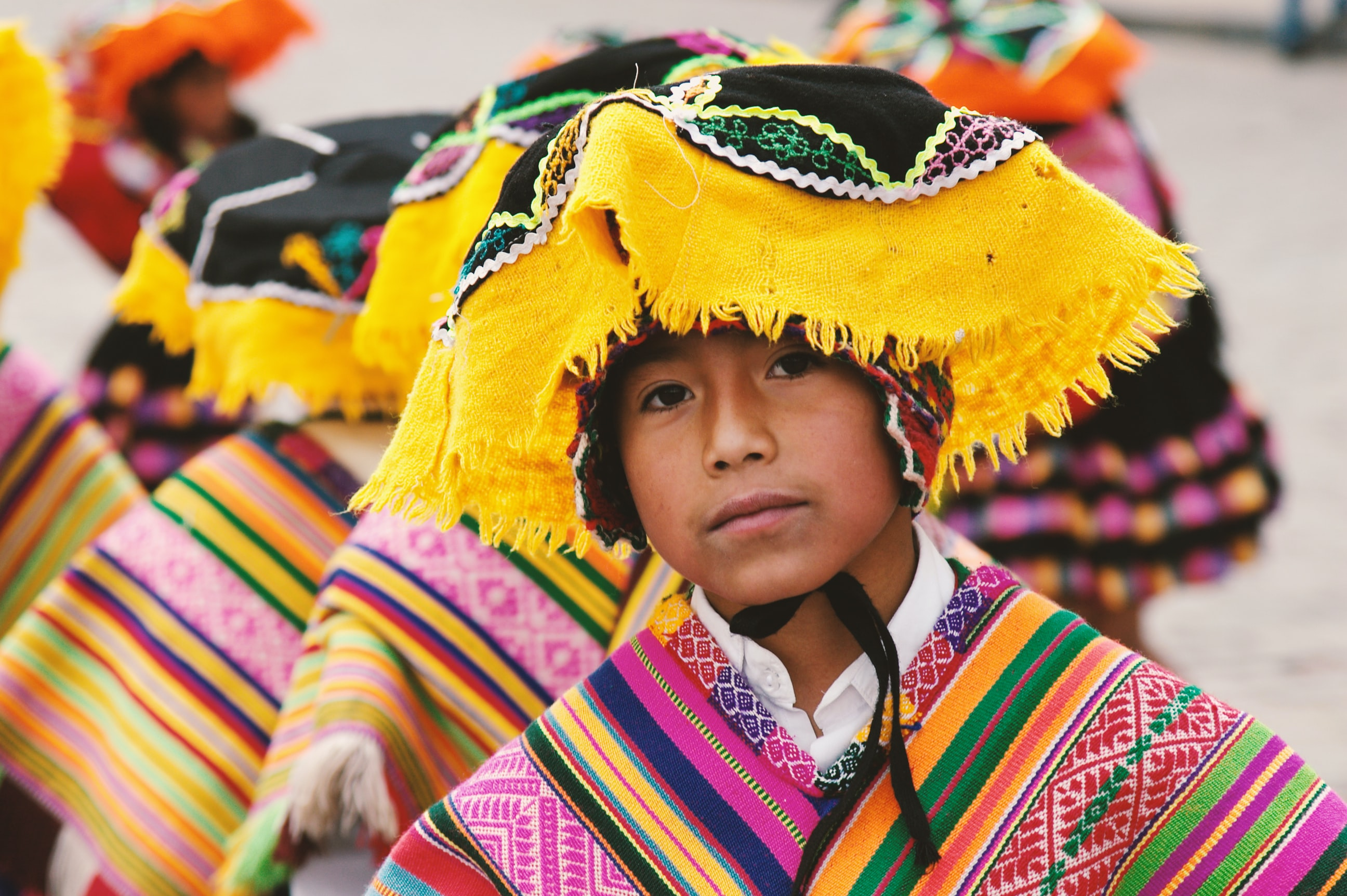 boy in traditional costume in shallow focus photography