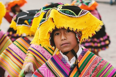 boy in traditional costume in shallow focus photography peru zoom background