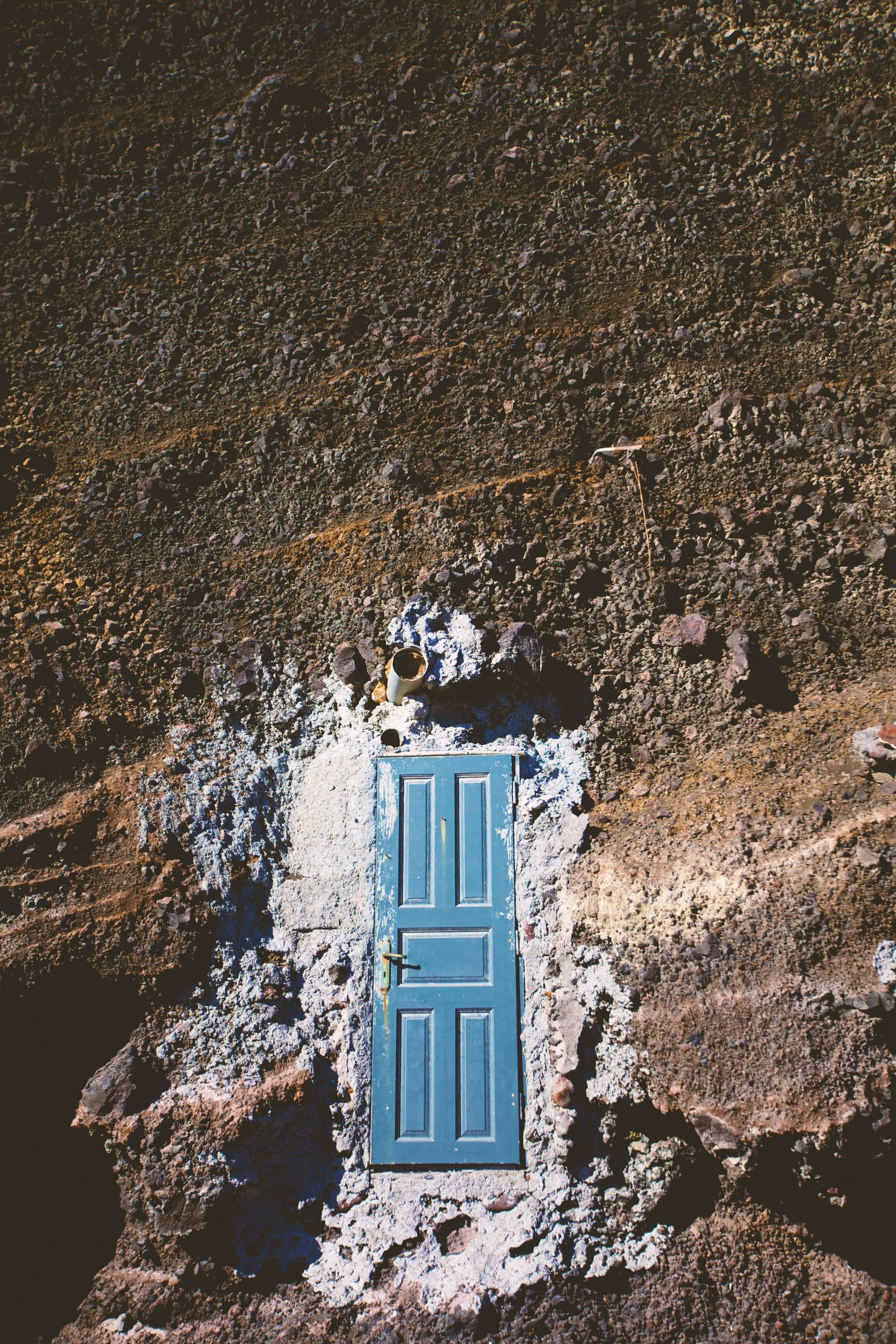 blue wooden 5-panel door