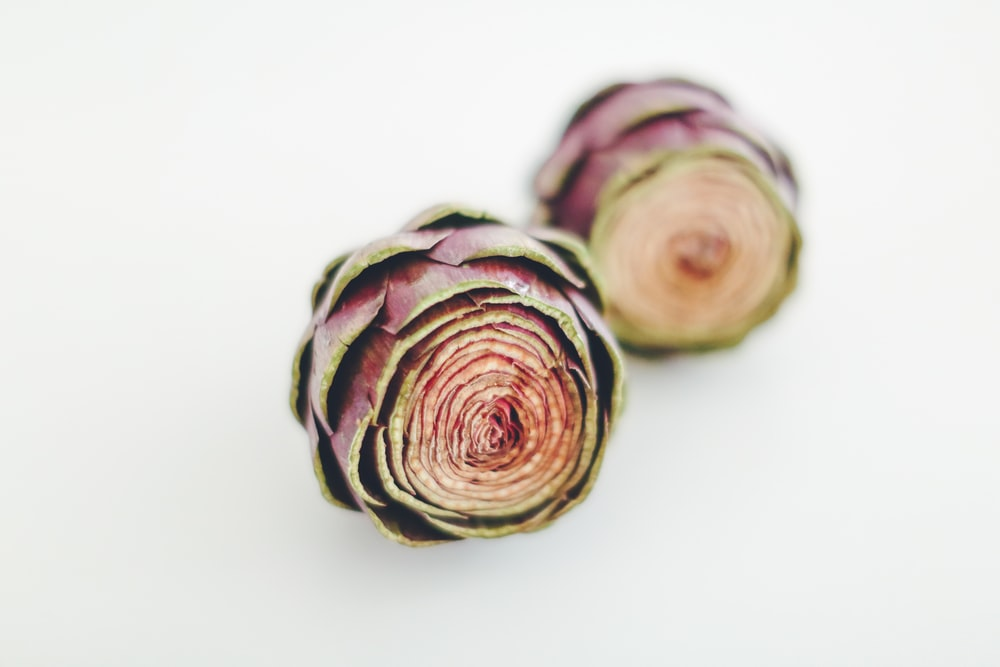 selective focus photography of red-and-green artichokes